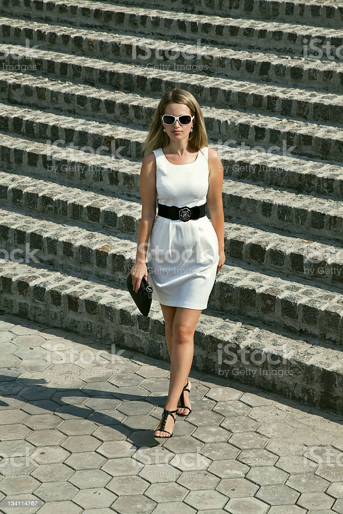 young businesswoman in white dress royalty-free stock photo