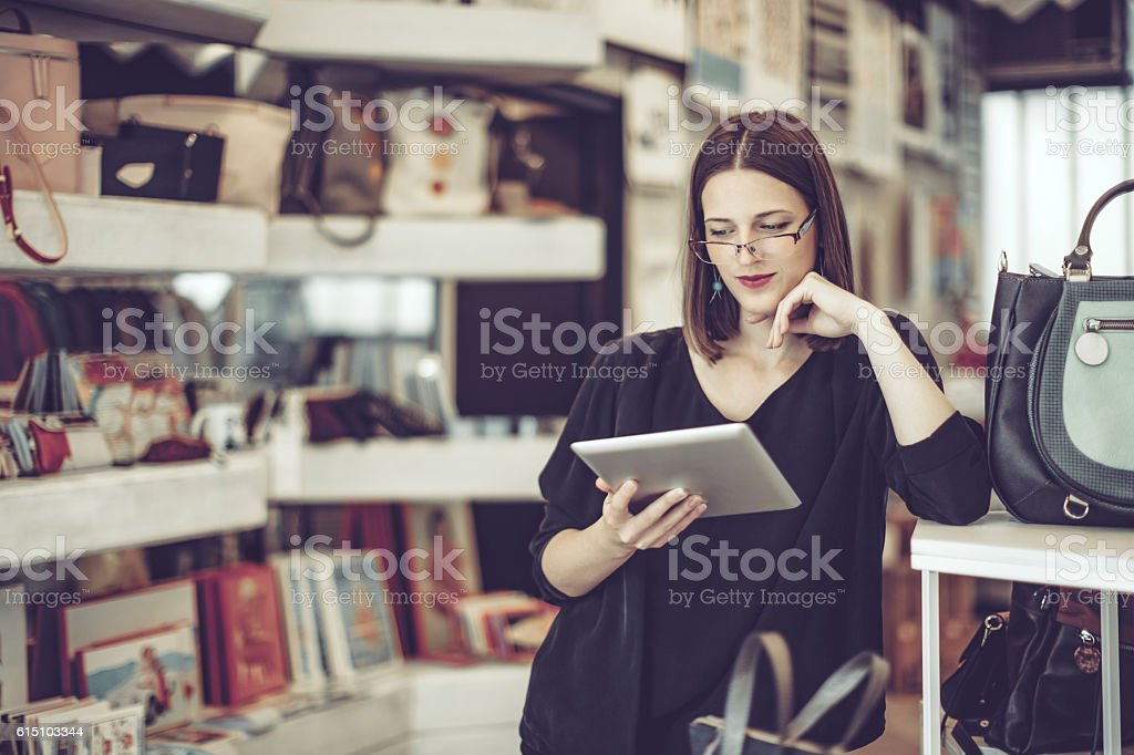 Young businesswoman is working in her store stock photo