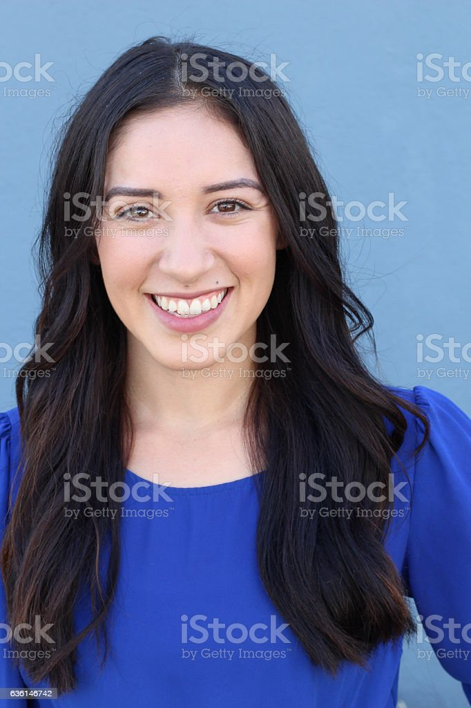 Young businesswoman isolated on blue background stock photo