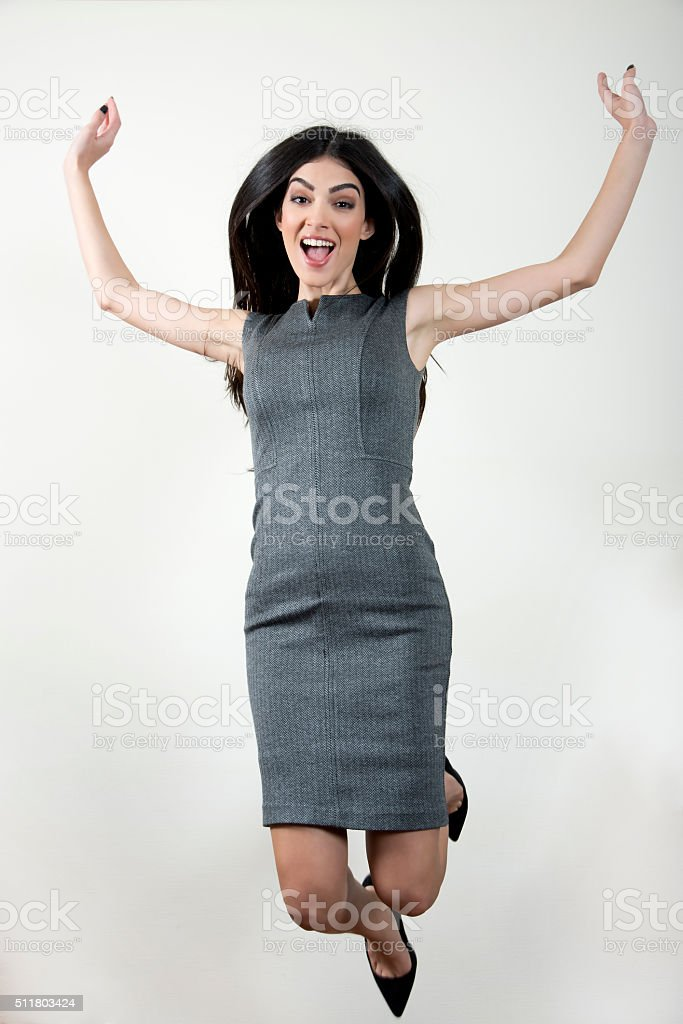 Young businesswoman jumping. stock photo