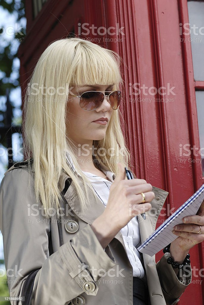Young businesswoman looking at notebook royalty-free stock photo