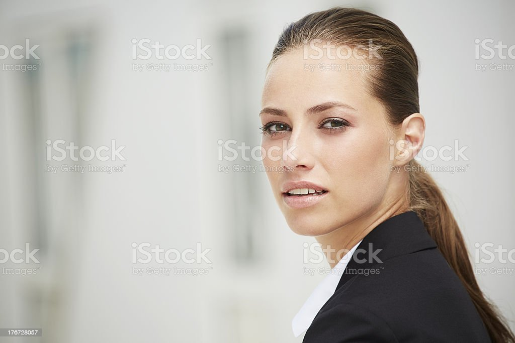 Young businesswoman looking away, close up royalty-free stock photo