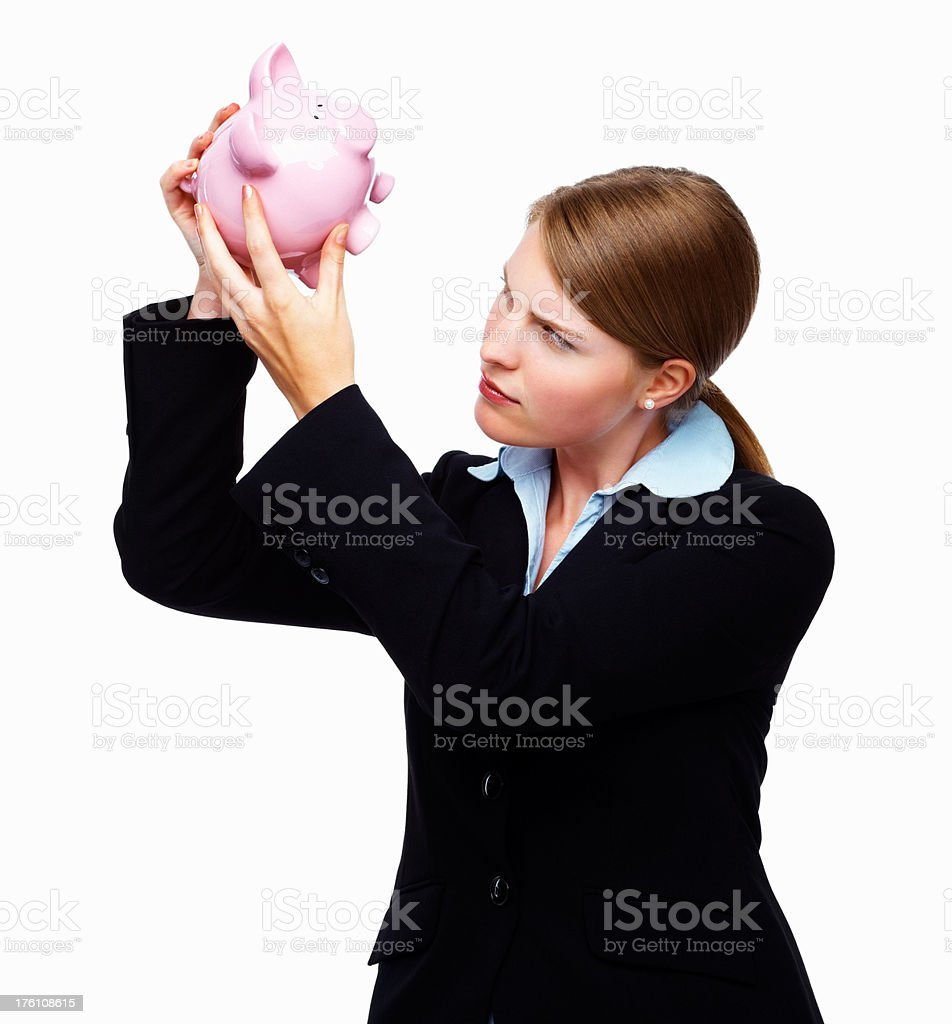 Young businesswoman looking into a piggybank royalty-free stock photo