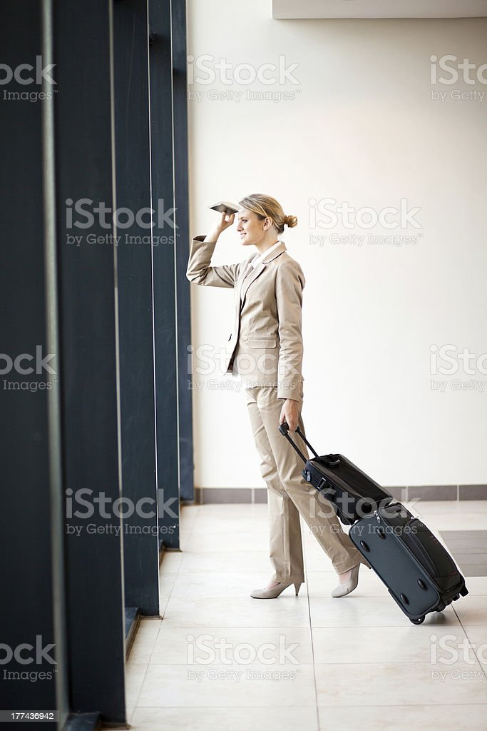 young businesswoman looking outside airport royalty-free stock photo