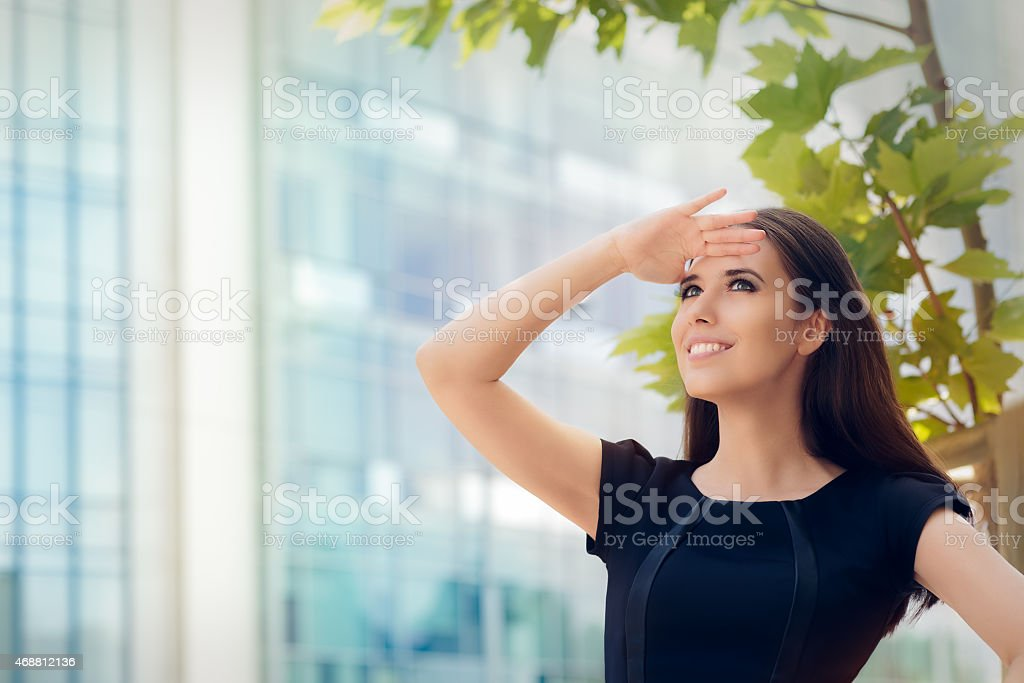 Young Businesswoman Looking Up  and Searching for Something stock photo