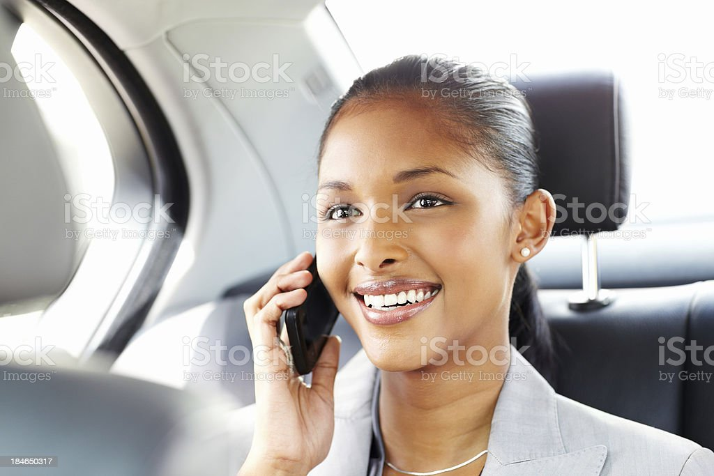 Young Businesswoman on a Cellphone While Traveling royalty-free stock photo