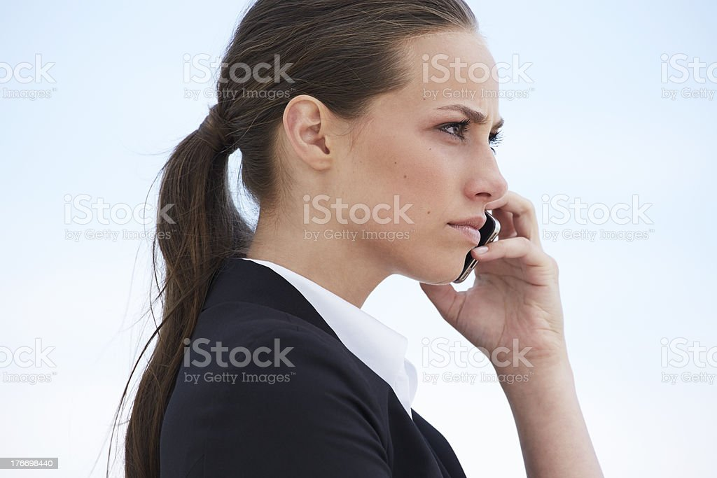 Young businesswoman on cellphone, looking away royalty-free stock photo