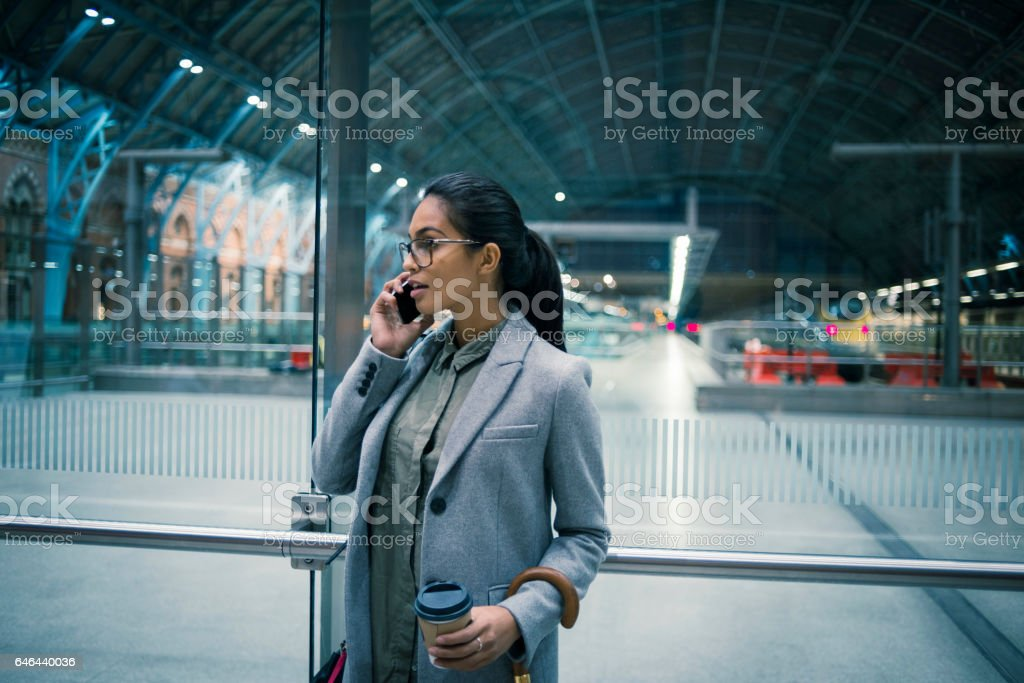 young businesswoman on the way from work stock photo