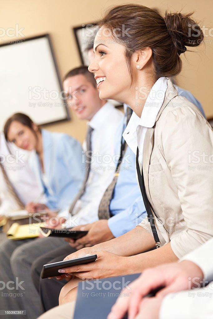 Young businesswoman participating in a lecture royalty-free stock photo