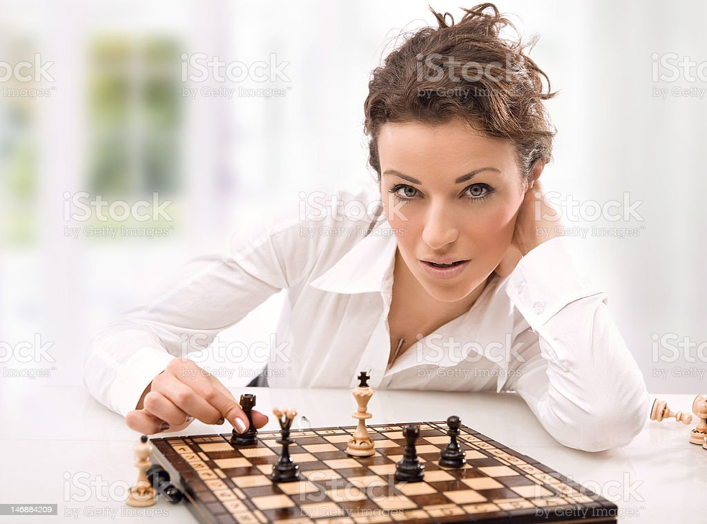 Young businesswoman playing chess royalty-free stock photo