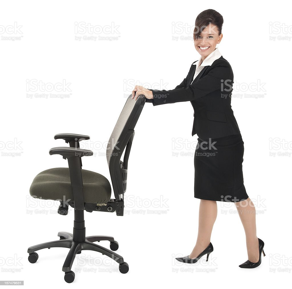 Young Businesswoman Pushing a Rolling Office Chair royalty-free stock photo
