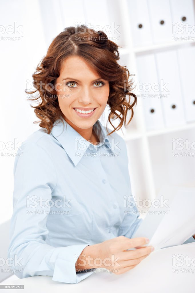 Young businesswoman reading document royalty-free stock photo
