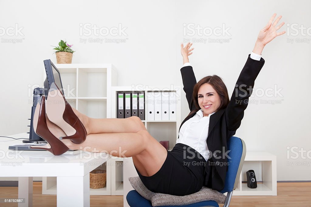Young Businesswoman Relaxing In Office stock photo