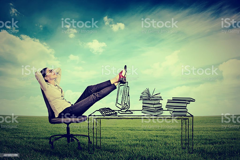 young businesswoman relaxing sitting in the office stock photo