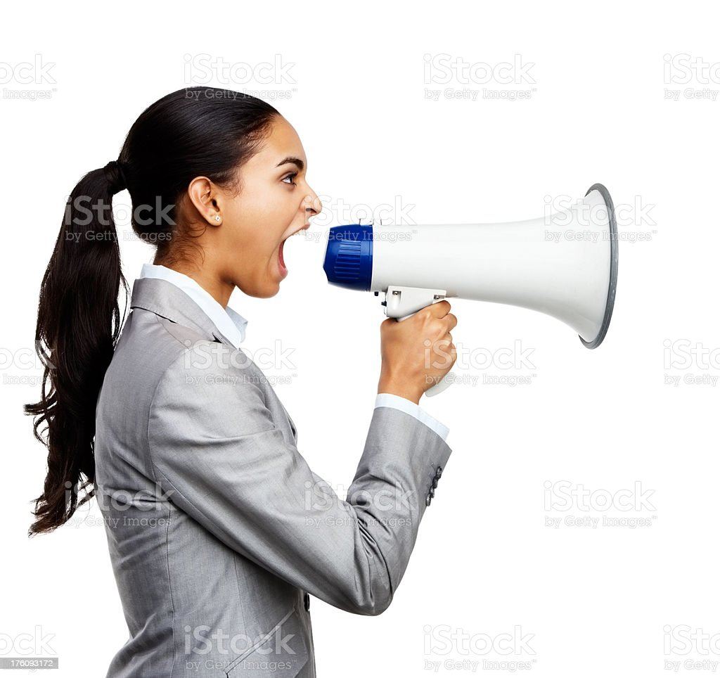 Young businesswoman shouting in megaphone royalty-free stock photo