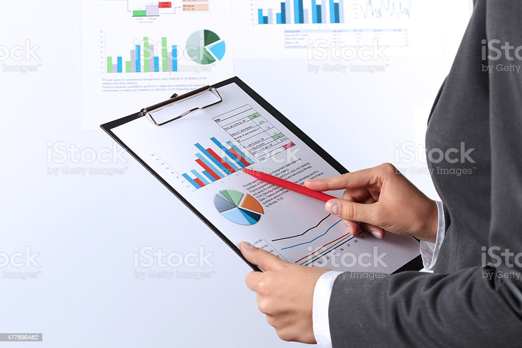young businesswoman showing graphs by pen stock photo