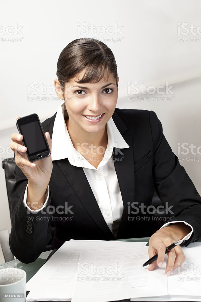 Young businesswoman showing smartphone royalty-free stock photo