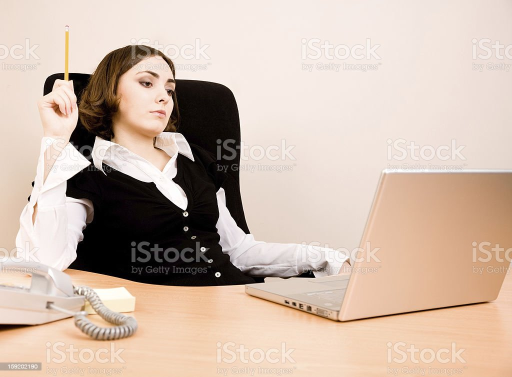 Young businesswoman sitting in the chair stock photo