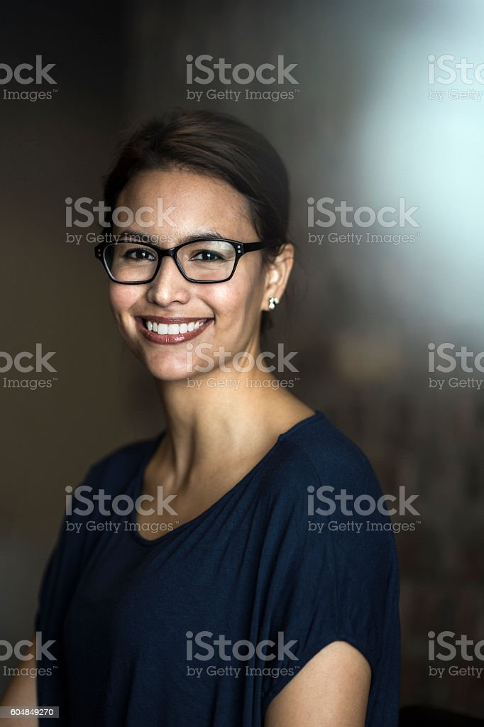 Young businesswoman smiling in office stock photo