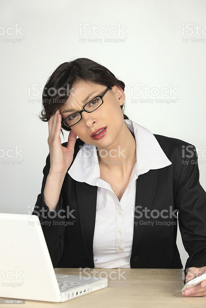 Young businesswoman stressed royalty-free stock photo