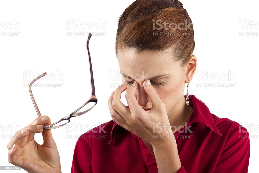Young businesswoman suffering from eyestrain stock photo