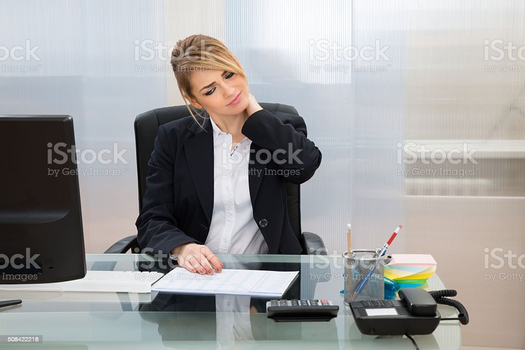 Young Businesswoman Suffering From Neckache stock photo