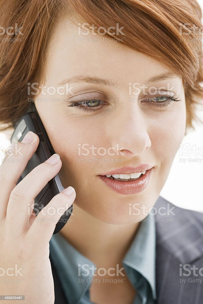 Young businesswoman talking on mobile phone royalty-free stock photo