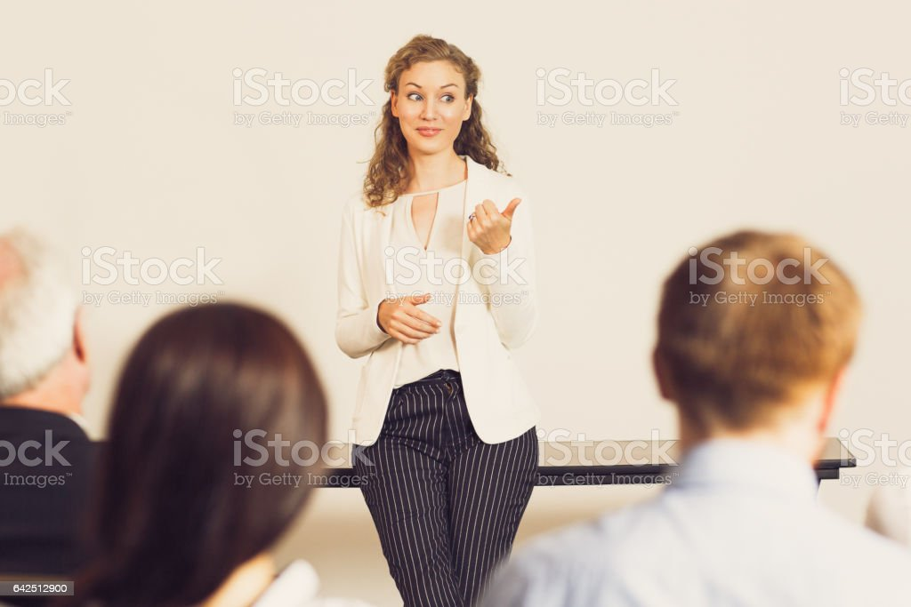 Young Businesswoman Talking to Team at Meeting stock photo