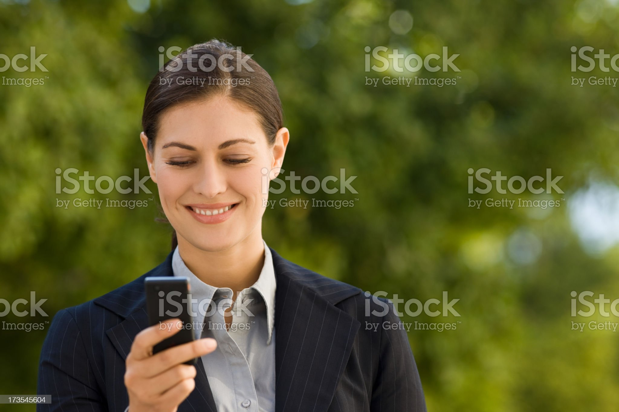 Young businesswoman text messaging on mobile phone royalty-free stock photo