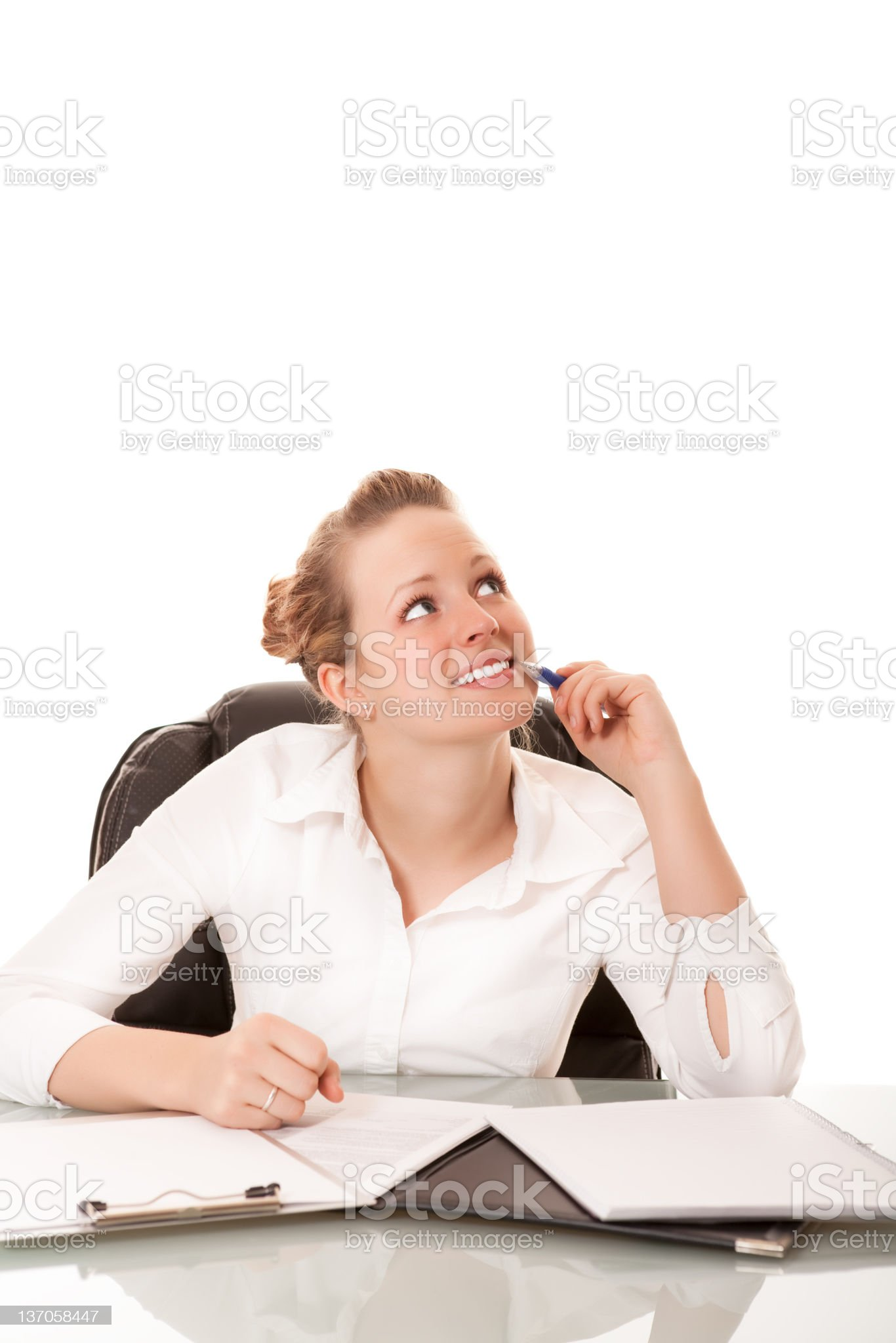 Young businesswoman thinking at her desk royalty-free stock photo
