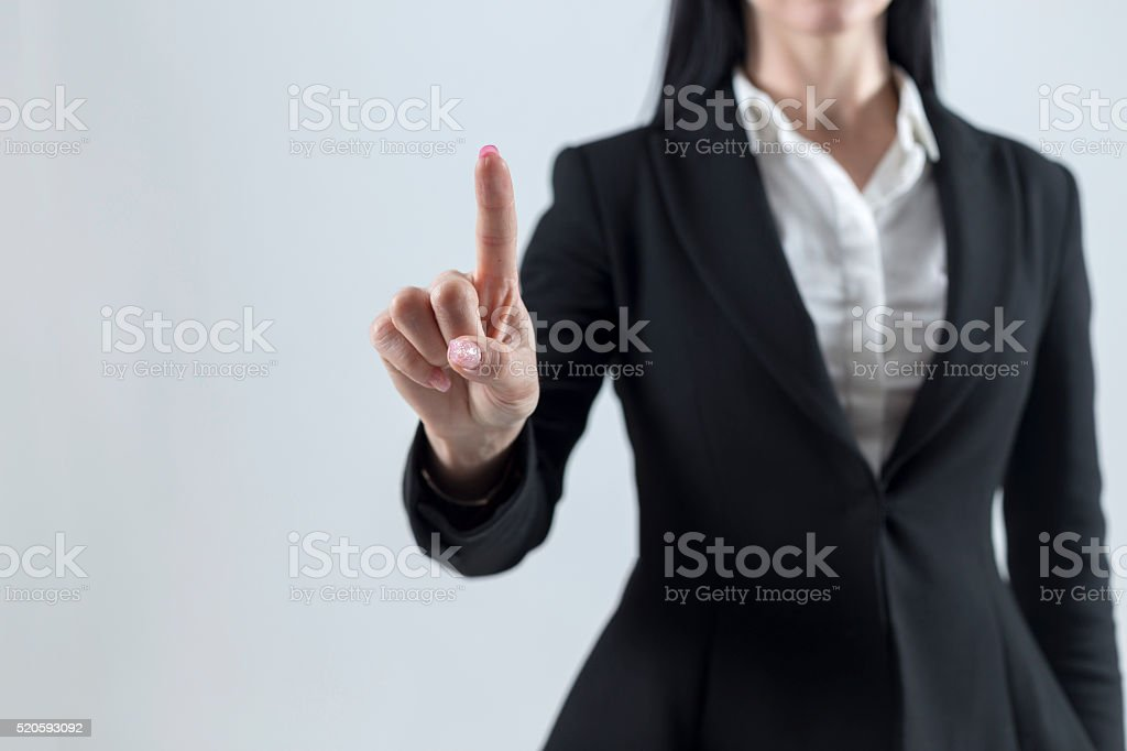 Young businesswoman touch screen consept stock photo