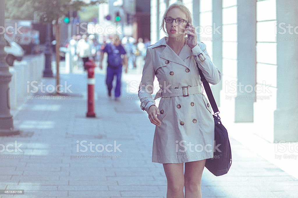 Young businesswoman using a mobile phone in the urban environmen stock photo