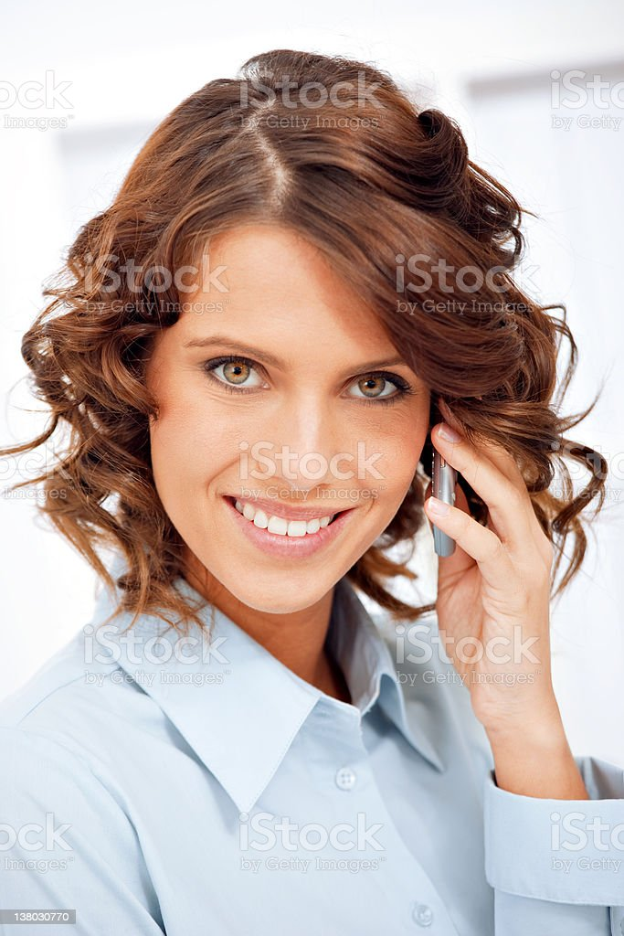 Young businesswoman using cellphone royalty-free stock photo