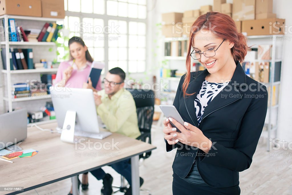 Young businesswoman using smart phone stock photo