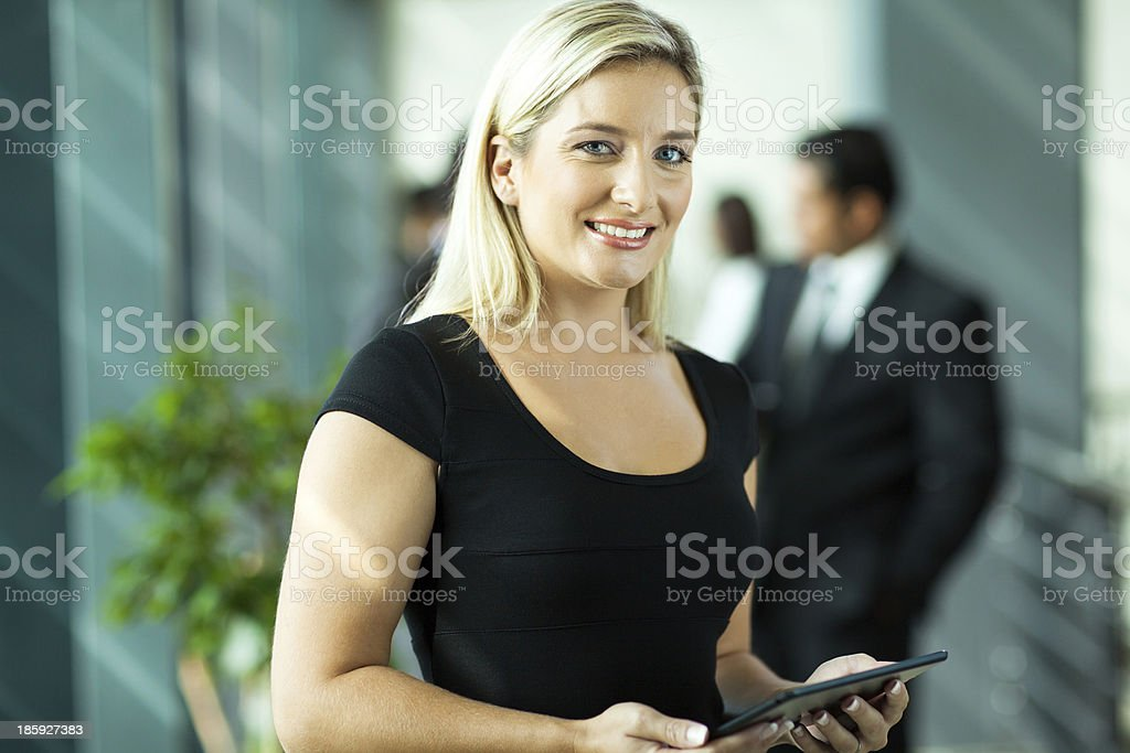 young businesswoman using tablet computer royalty-free stock photo