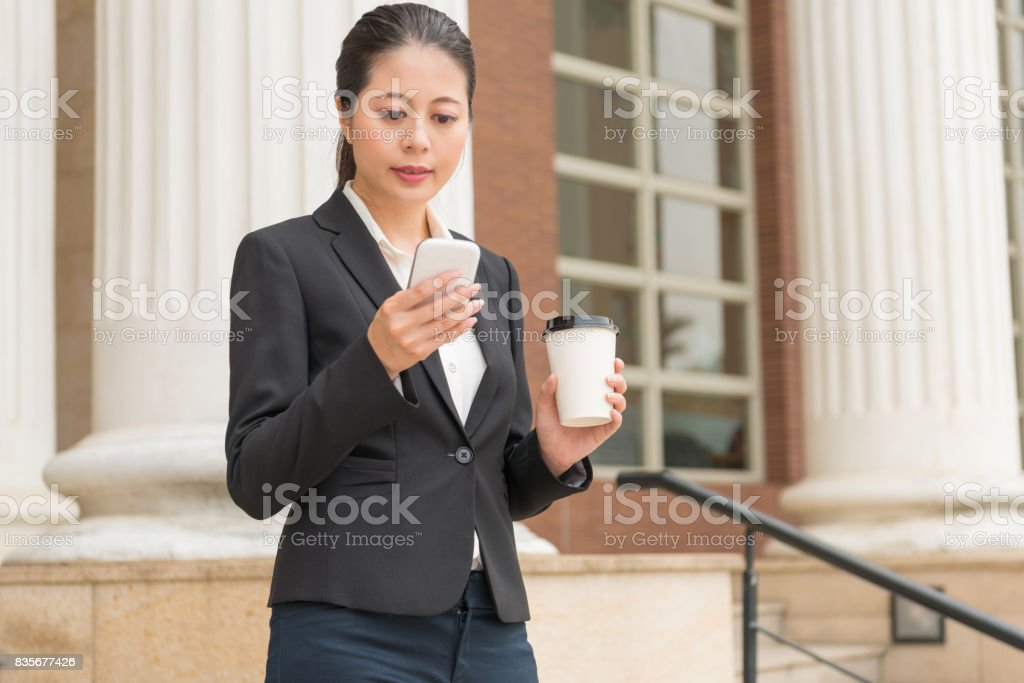 young businesswoman using the mobile phone stock photo
