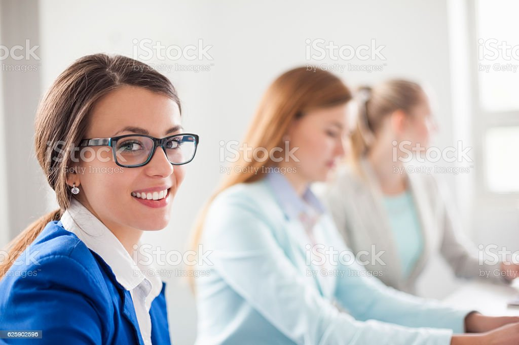 Young businesswoman with colleagues in meeting at creative office stock photo