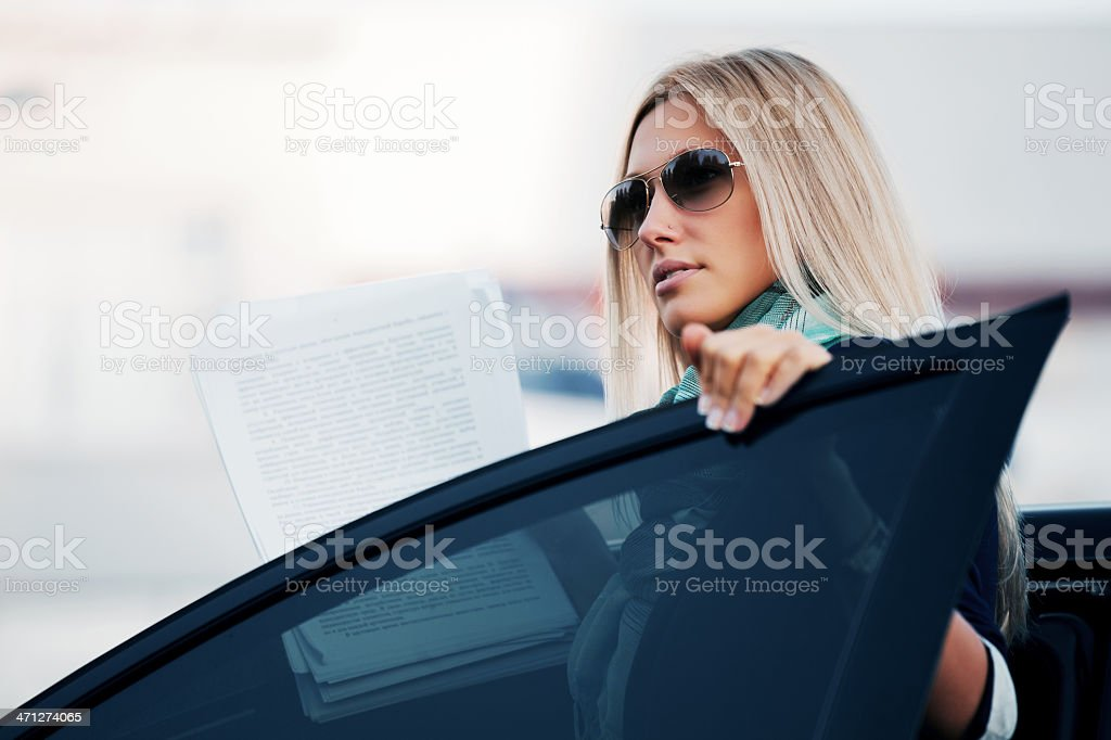 Young businesswoman with financial reports royalty-free stock photo