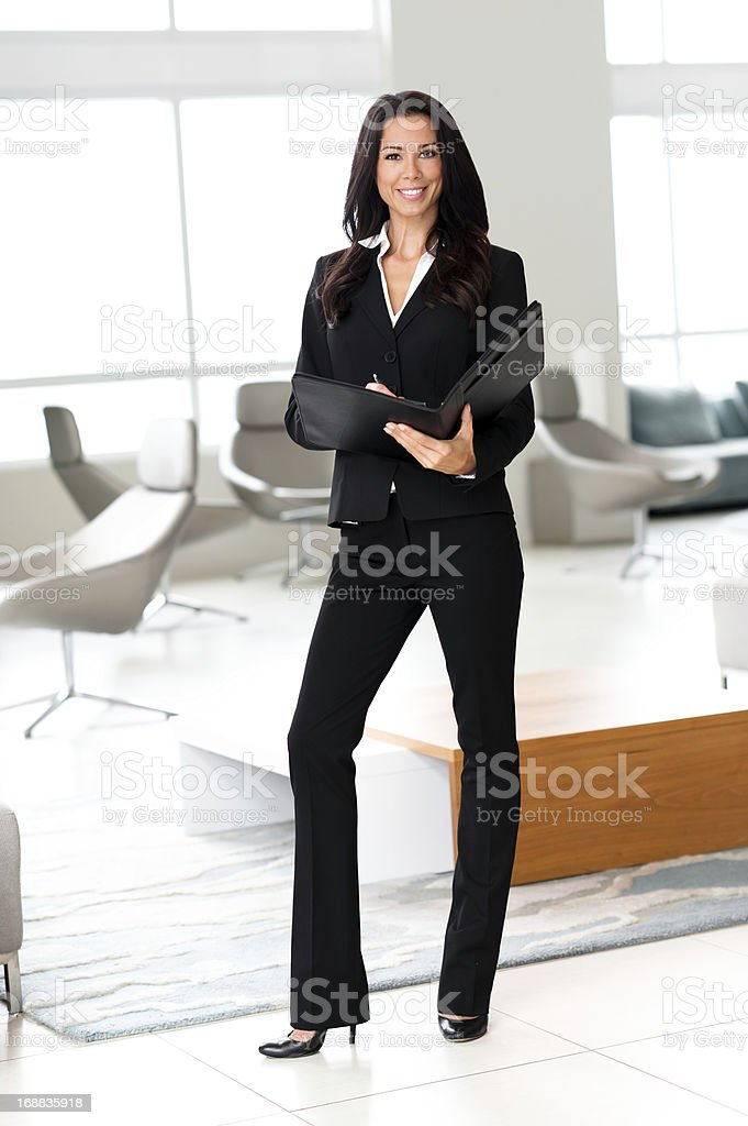 Young Businesswoman with Folio Folder Showcase Home royalty-free stock photo