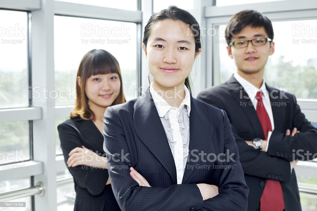Young businesswoman with her colleagues in the background royalty-free stock photo