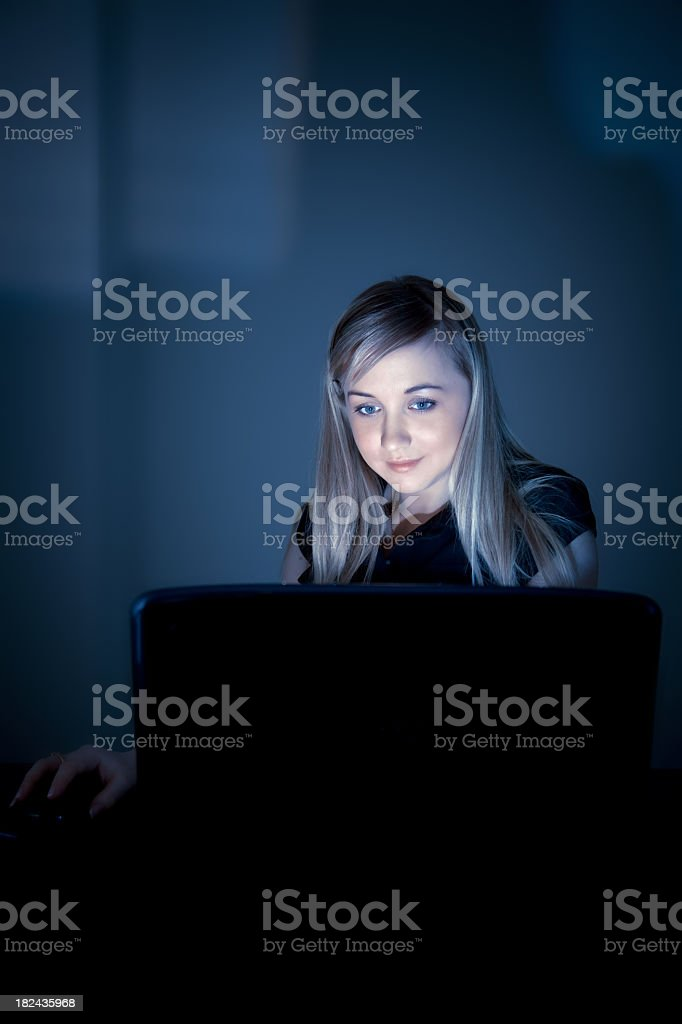 Young businesswoman with laptop at night royalty-free stock photo