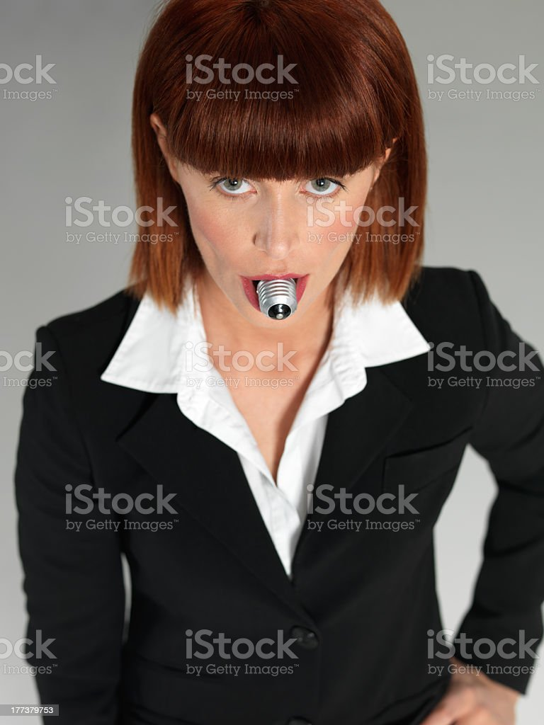young businesswoman, with light bulb in mouth royalty-free stock photo