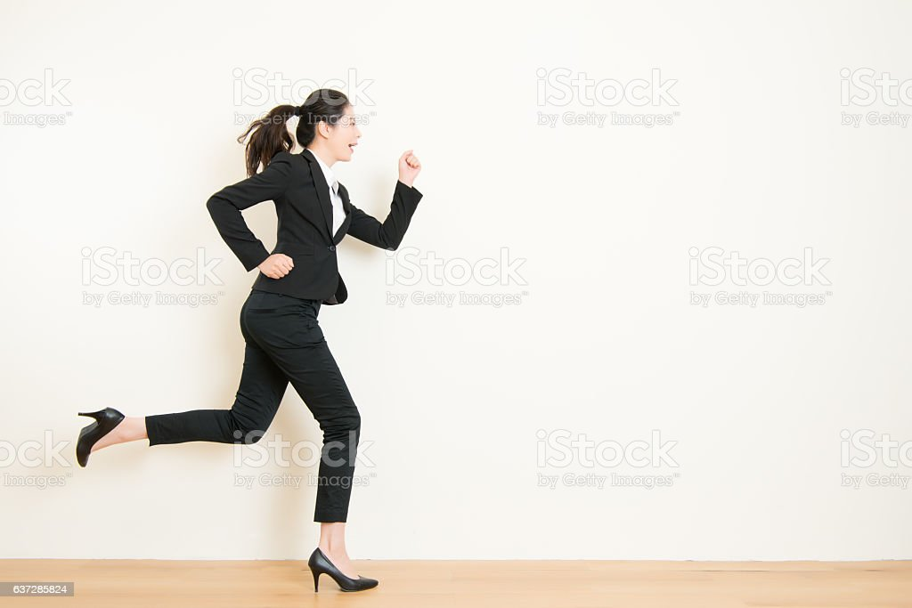 Young businesswoman with running on white background stock photo