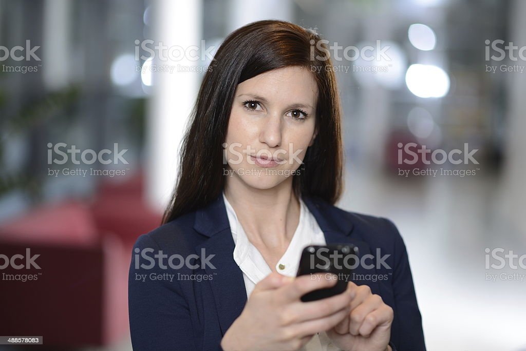 Young businesswoman with smartphone stock photo