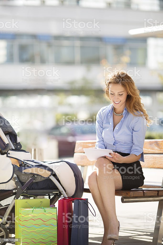 Young Businesswoman With Strollers Outdoors. royalty-free stock photo