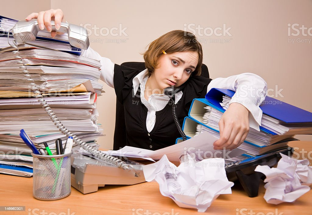 Young businesswoman with tons of documents royalty-free stock photo