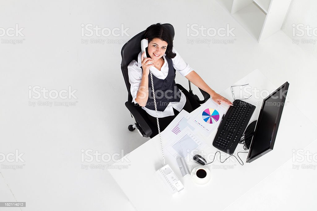 young businesswoman working in office royalty-free stock photo