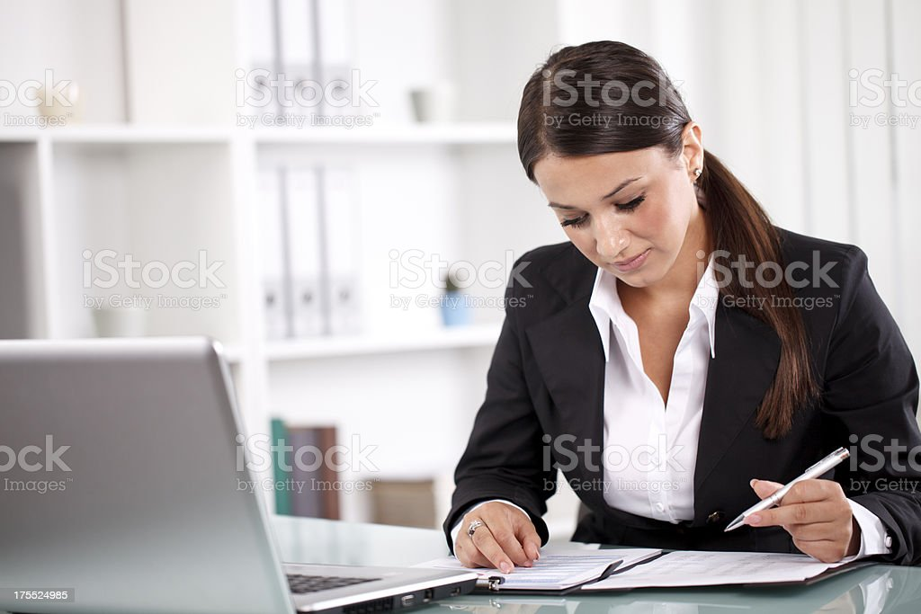 Young businesswoman working on documents royalty-free stock photo