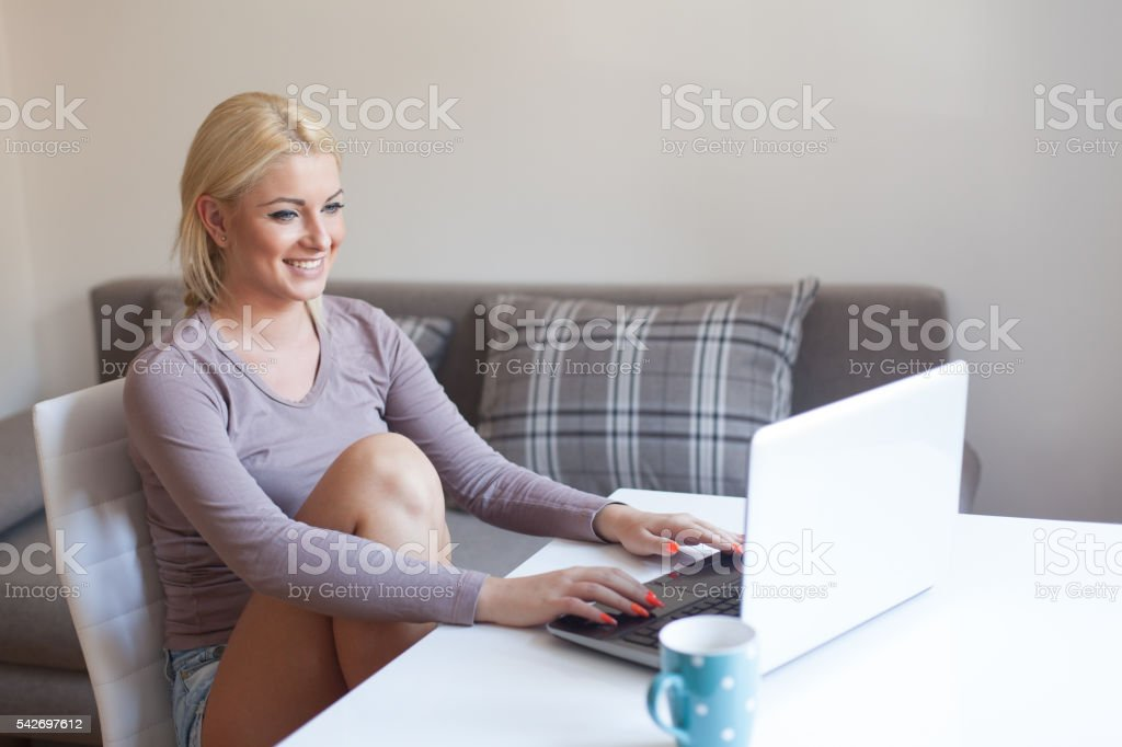 Young businesswoman working on the desk stock photo