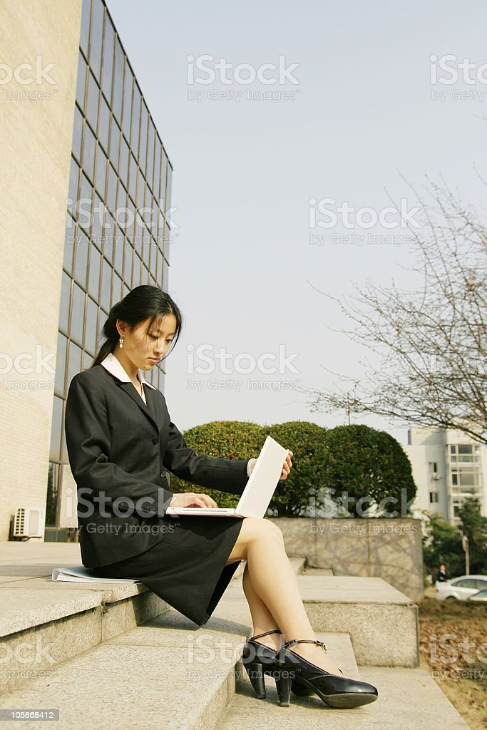 young businesswoman working with laptop royalty-free stock photo